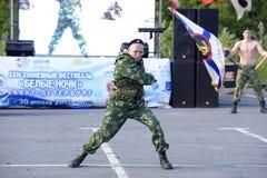Possession of nunchaku commando shows Royalty Free Stock Photo