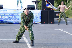 Possession of nunchaku commando shows Stock Photography