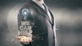 Possiamo aiutare le nuove tecnologie disponibile di Holding dell'uomo d'affari Fotografie Stock Libere da Diritti