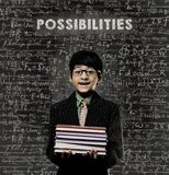 Possibilities. Genius Little Boy Holding Book Wearing Glasses Stock Photography