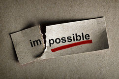 Possible. Word impossible transformed into possible. Motivation philosophy concept Stock Photo