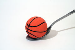 Possible !!!. Basket ball in a spoon Royalty Free Stock Photography