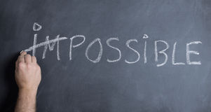 Possible. Making the impossible possible concept of motivation Royalty Free Stock Photography