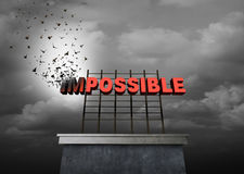 Possible Positive Thinking. Concept as a success motivational symbol as text with the word impossible being transformed by birds on a sign to create the Royalty Free Stock Photo