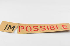 Possible. Tearing the word Impossible for Possible Royalty Free Stock Photos