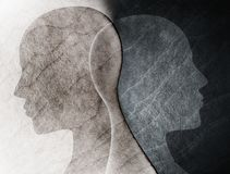 Bipolar disorder mind mental concept. Change of mood. Emotions. Split personality. Dual personality. Head silhouette of man on bla. Possible use in highlighting stock illustration