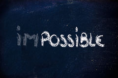 Possible vs. impossible, challenge concepts on blackboard Stock Photo