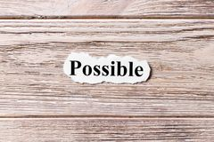 Possible of the word on paper. concept. Words of possible on a wooden background.  royalty free stock photography