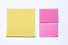 Post-it. Yellow and pink blank post-it notes isolated on white Stock Photography