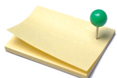 Post-it. A yellow post-it with a green pin Royalty Free Stock Image