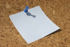 Post-it. Post-in on brown corkboard Stock Image