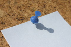 Post-it. Post-in on brown corkboard. Shadow royalty free stock photography