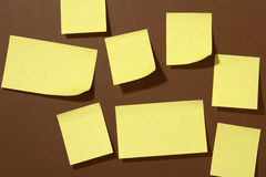 Post-it. A lot of Post-it on brown background Royalty Free Stock Photography