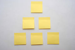 Post-it. A lot of yellow triangle post-it note Stock Images