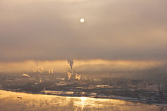 Post-apocallipic dawn. Yenisey river, smoke on the city Royalty Free Stock Photos