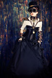 Post-apocalypse. Portrait of a beautiful steampunk woman over grunge background Royalty Free Stock Photo