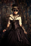 Post-apocalypse. Portrait of a beautiful steampunk woman over grunge background Royalty Free Stock Images
