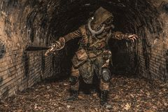 Post apocalyptic underground creature in gas mask