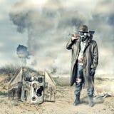 Post apocalyptic survivor holding axe. Environmental disaster. Post apocalyptic survivor in gas mask holding axe stock photo