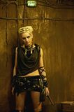 Post-apocalyptic tribal woman in shelter Royalty Free Stock Photography