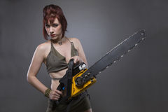 Post Apocalyptic Woman with chainsaw Stock Photography