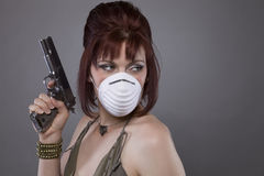 Post Apocalyptic Woman pointing gun Royalty Free Stock Images