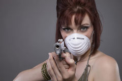 Post Apocalyptic Woman pointing gun Stock Photography