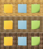 Post it attached on wood pattern Stock Images