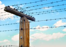 Post with barbed wire Stock Photography