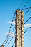 Post with barbed wire against the sky Stock Photo