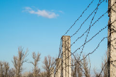 Post with barbed wire against the sky Stock Photos