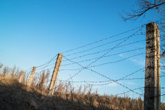 Post with barbed wire against the sky Royalty Free Stock Photos
