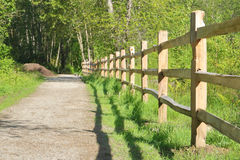 Post and Beam Cedar Fence. A long traditional post a beam cedar fence on a nature pathway Royalty Free Stock Photography