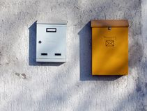 Post box. Two ordinary post boxes on the white wall Royalty Free Stock Image