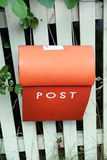 Post Box. Fence holding a residential mail box Royalty Free Stock Photography