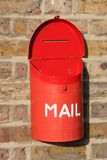 Post box. Red post box on the wall Stock Images