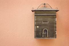 Post box. Metal post box on the beige wall Stock Image