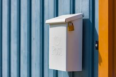 Post box on wooden fence. Norway, Europe stock photo