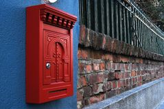 Post box on brick wall Stock Image