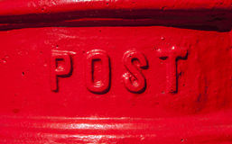 Post Box. A close-up of the word 'Post' on a red Post Box in the England Stock Photos