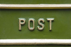 Post Box. Close-up of the word POST on a traditional Victorian post box in the UK Stock Photo