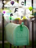 Post box with colorful letters royalty free stock photos