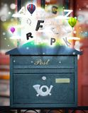 Post box with colorful letters royalty free stock image
