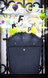 Post box with colorful letters royalty free stock photo