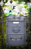 Post box with colorful letters Stock Photo