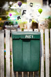 Post box with colorful letters Stock Photography
