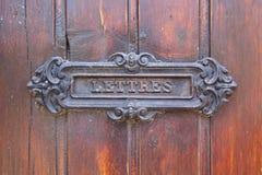 Post box in a door Stock Image