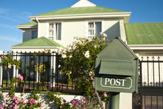 Post box and house Royalty Free Stock Image
