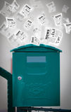 Post box with daily newspapers flying Stock Images