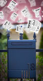 Post box with daily newspapers flying Royalty Free Stock Photography